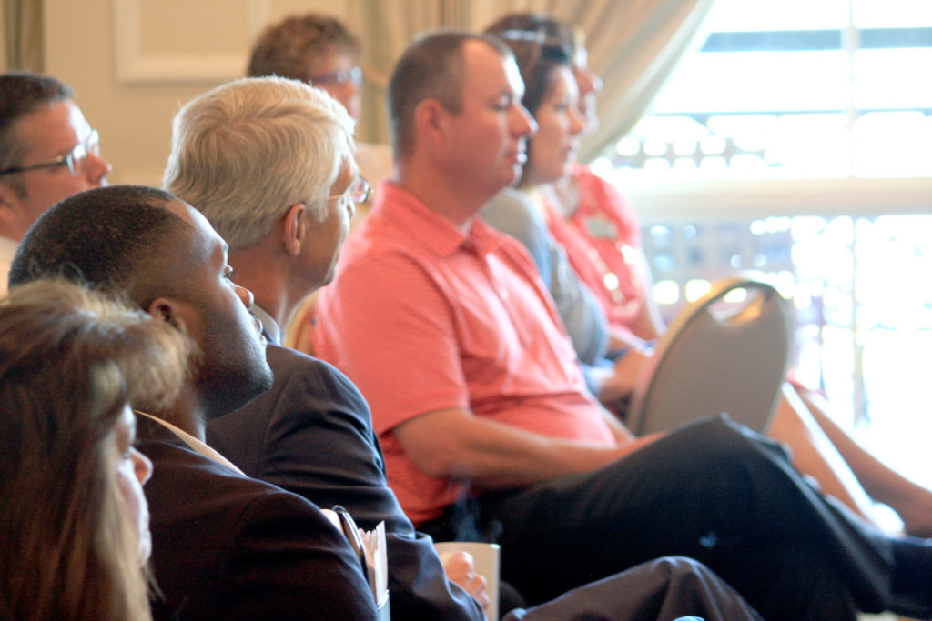 Coffee sponsor Chris Davis of Davidson Wealth Management looks on