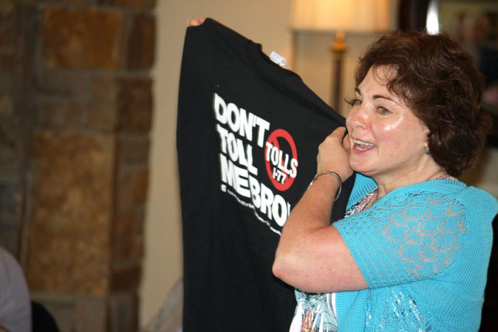 Anti-toll activist Sharon Hudson displays an anti-toll t-shirt