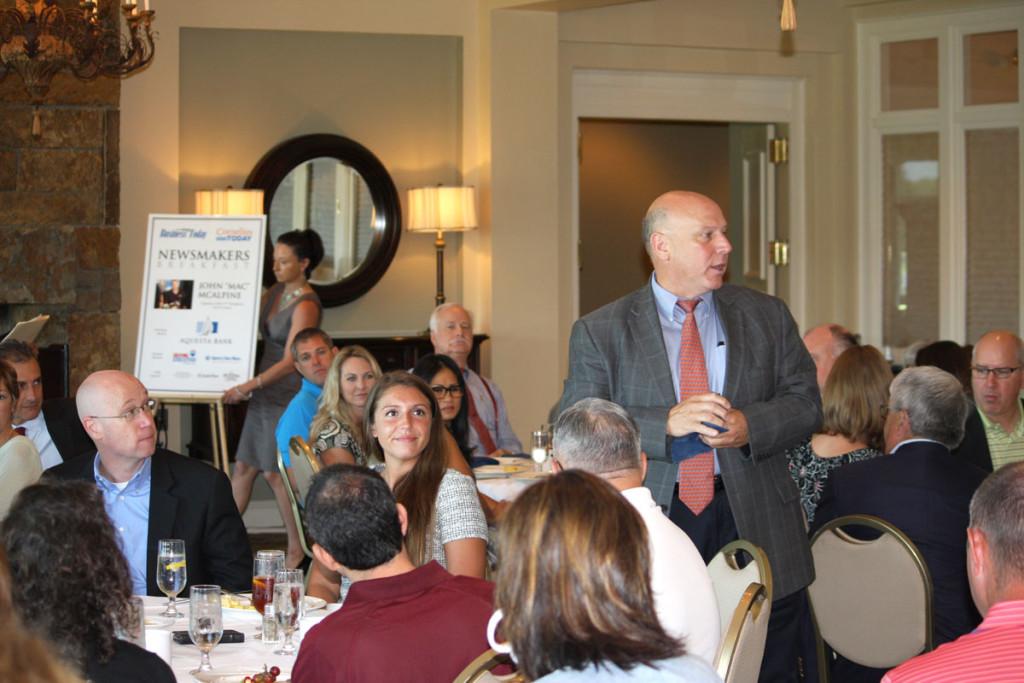 Breakfast sponsor Tom McMahon of Sperry Van Ness introduces his team