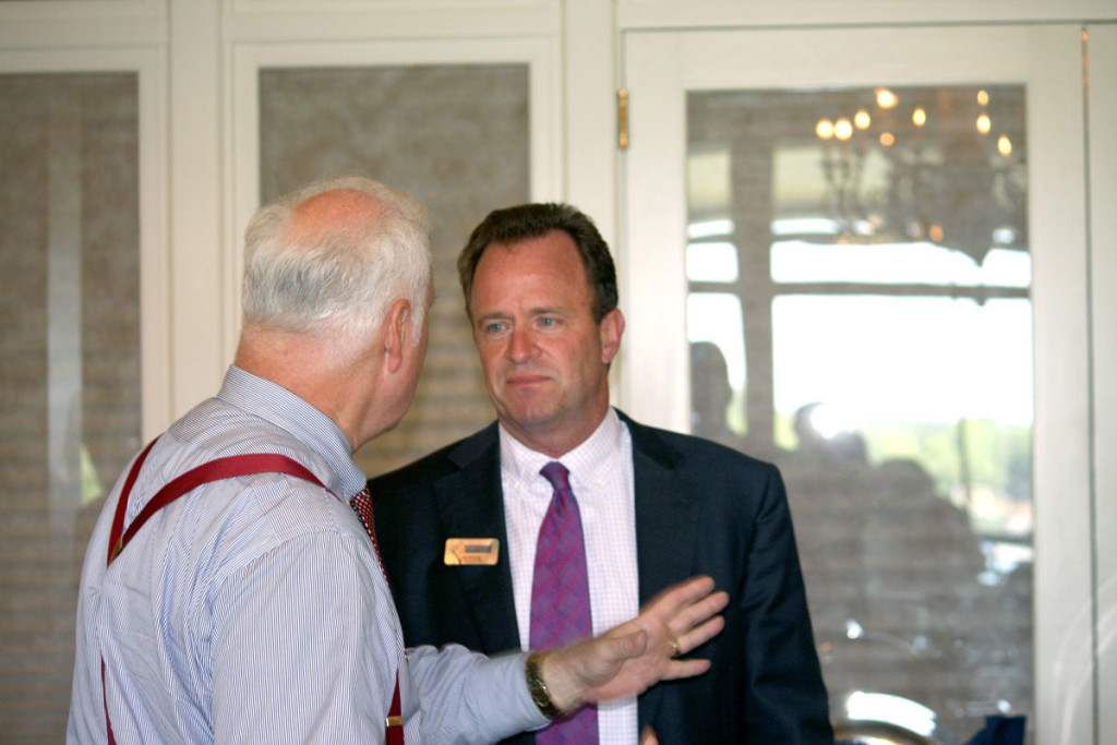 Mecklenburg County commissioner talks to Aquesta's Jim Engel after the breakfast