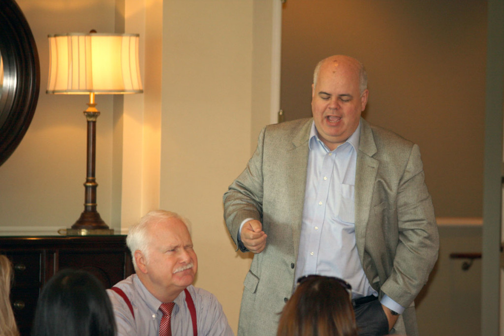 NCDOT's Warren Cooksey responds to a question while Commissioner Puckett listens