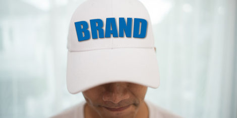 Blank white cap on the head ready for branding.